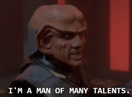 Quark wearing Klingon armor and Ferengi headdress