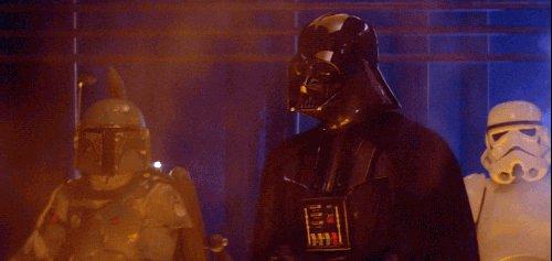 Darth Vader prevents Boba Fett from shooting